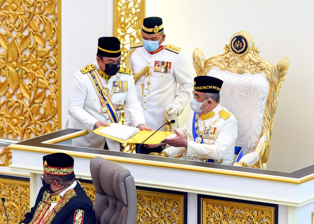 Melaka Yang Dipertua Negeri Tun Mohd Ali Rustam receives the text of the opening speech from Chief Minister Datuk Seri Sulaiman Md Ali (left) in conjunction with the opening of the fourth term of the 14th Melaka State Legislative Assembly at Kompleks Seri Negeri, September 20, 2021. — Bernama pic