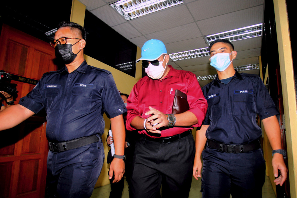 Mohd Faizal Amir, 32, was charged with 10 counts of performing unnatural sex and 22 counts of committing physical sexual assault on the students aged 14 to 16 at a secondary school warden's house in Tapah between July 28 and September 28, 2020. — Bernama pic