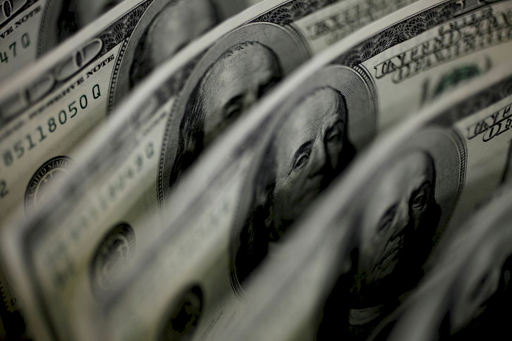 The dollar held near three-week highs on Friday. — Reuters pic