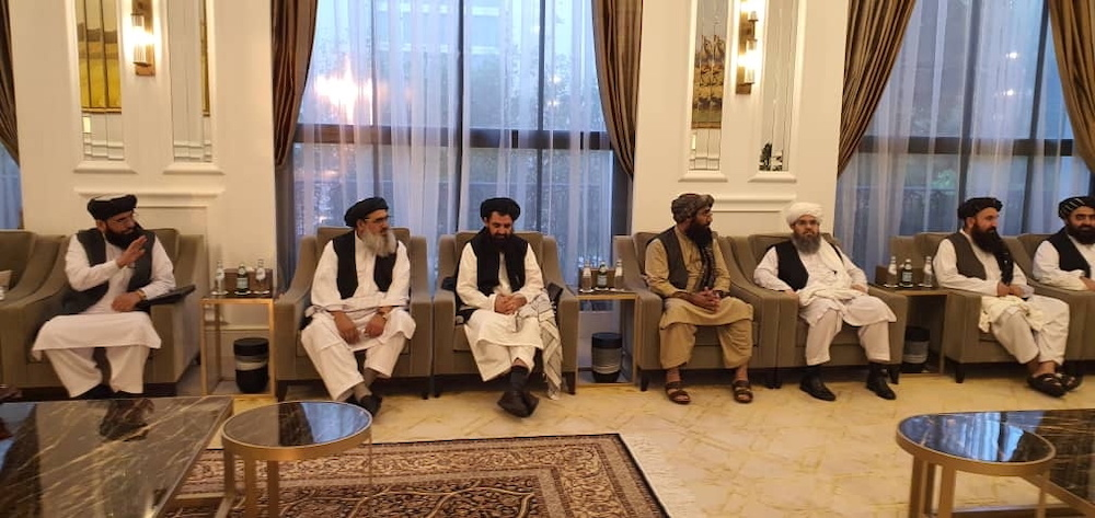 Taliban delegates meet with Qatar delegates in Doha, Qatar, in this handout photo uploaded to social media on October 9, 2021. — Social media handout via Reuters