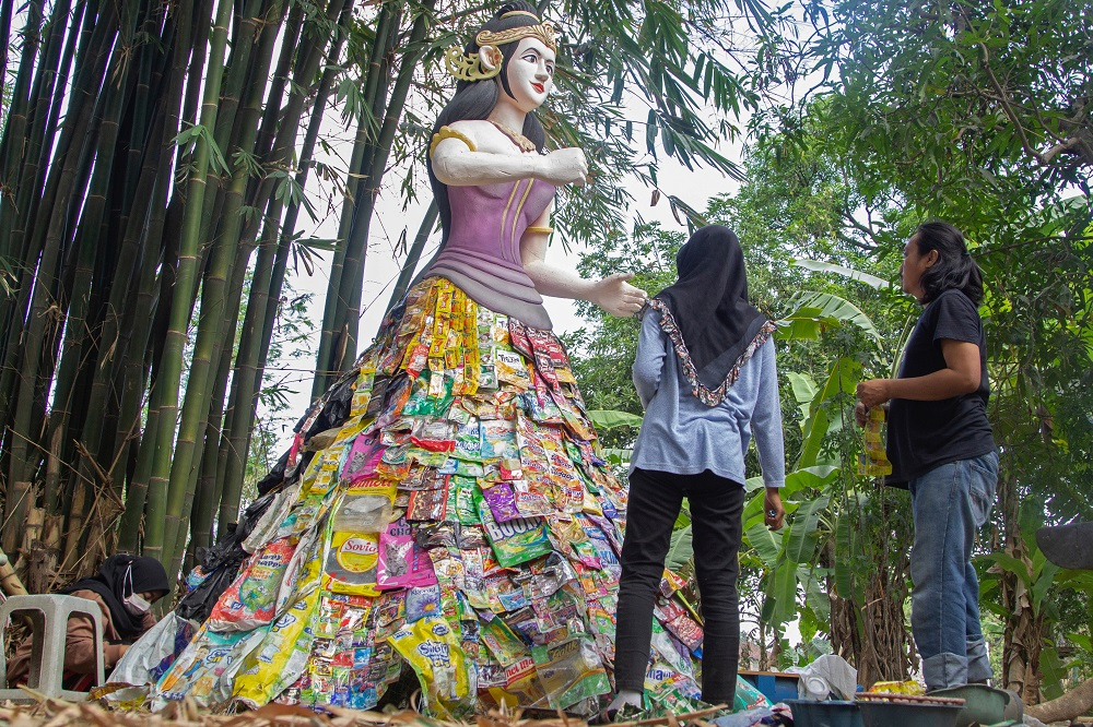 Volunteers of Indonesia's environmental activist group Ecoton built a mock-up of the Goddess Sri from plastic waste collected from several rivers around the city, at the plastic museum in Gresik regency near Surabaya September 28, 2021. — Reuters pic