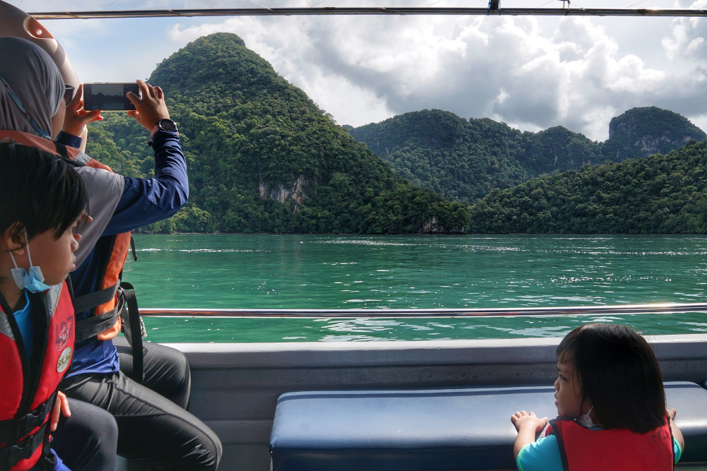 A tourist takes a picture of Pulau Dayang Bunting in Langkawi September 26, 2021. — Picture by Ahmad Zamzahuri