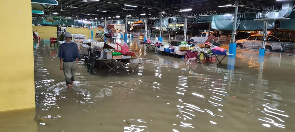 Last night's heavy downpour flooded areas in Penampang, Sabah for the third time in a month. — Picture courtesy of Sabah Civil Defence Department
