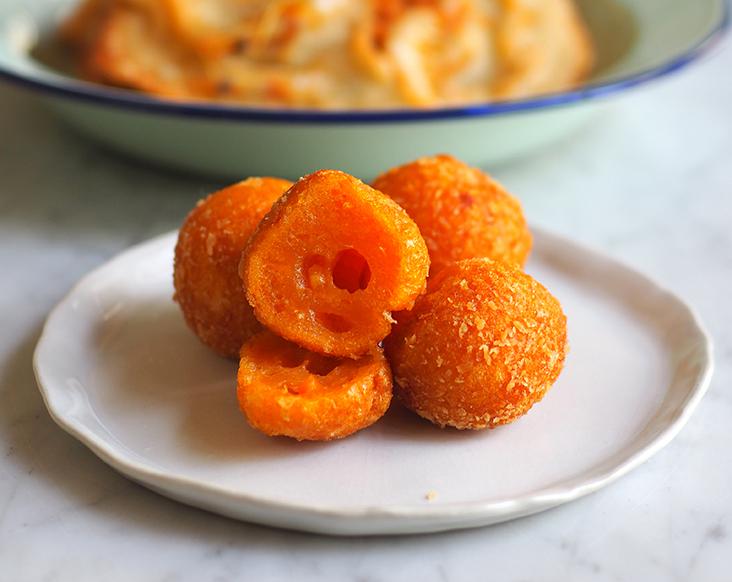 Inside the deep fried sweet potato balls, the dough has a chewy mochi-like texture.