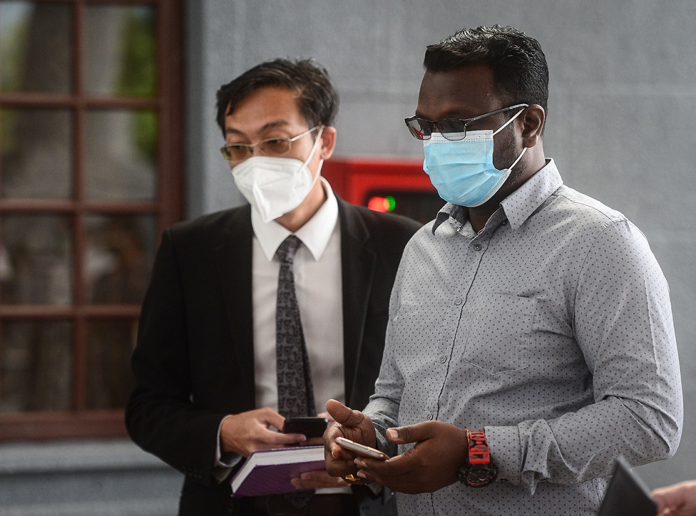 Malaysia-Singapore Workers Task Force chairman S. Dayalan (right) at the Sessions Court in Kuala Lumpur October 12, 2021. — Bernama pic