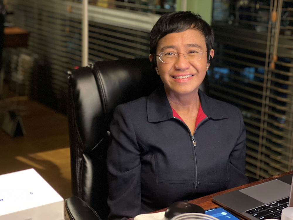 Filipino journalist and 2021 Nobel Peace Prize winner Maria Ressa sits by the desk at her home in Manila, Philippines, October 8, 2021. — Reuters pic
