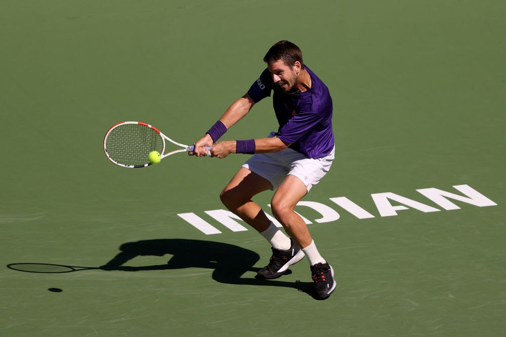 Cameron Norrie of Great Britain hits a backhand against Diego Schwartzman of Argentina in their match on Day 11 of the BNP Paribas Open on October 14, 2021 in Indian Wells, California. — AFP pic