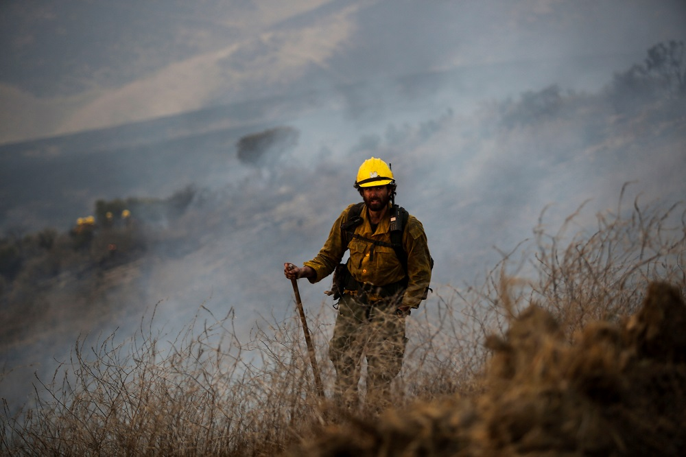 A firefighter work on a ranch in Aguajito Canyon in Santa Barbara County, California October 12, 2021. ― Reuters pic