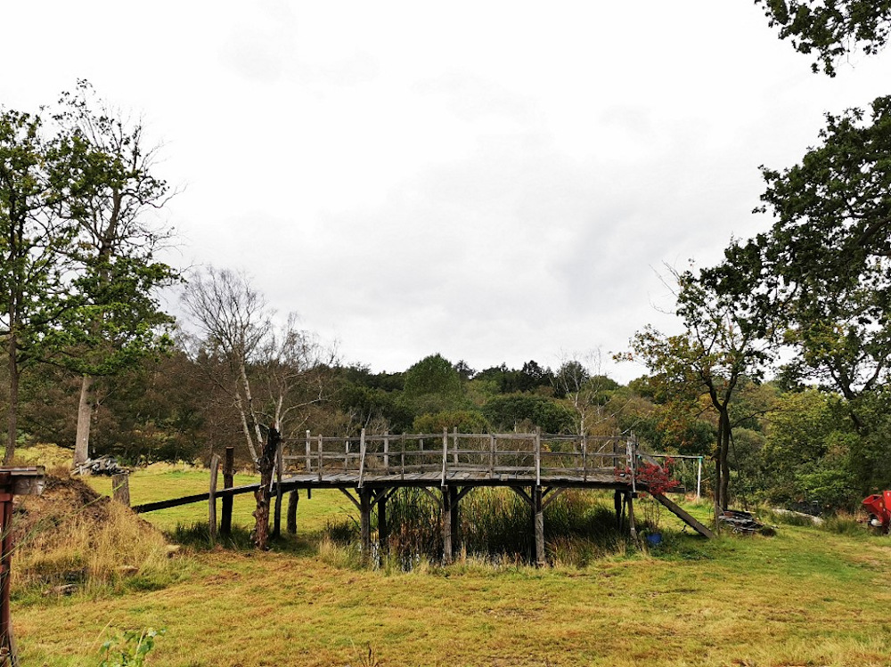 This undated handout photograph received from Summers Place Auctions in London on October 5, 2021, shows a wooden bridge, originally known as Posingford Bridge, that was constructed in 1907 in Ashdown Forest and which inspired Winnie the Pooh author AA Milne to write the books following a game of 'Poohsticks' with his son Christopher. — AFP pic