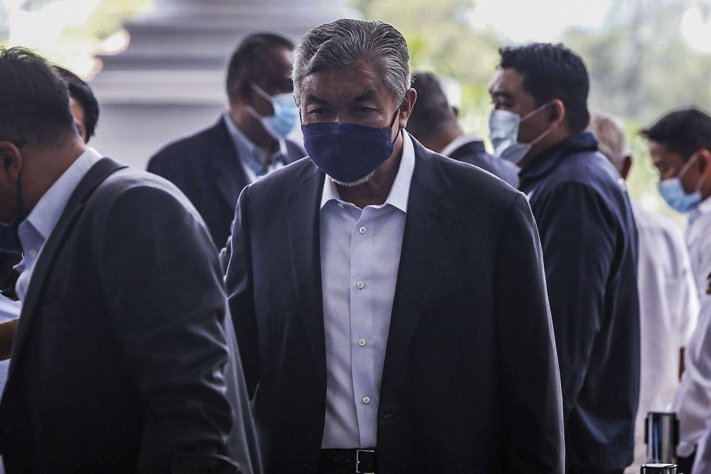 Datuk Seri Ahmad Zahid Hamidi arrives at the Kuala Lumpur High Court October 11, 2021. — Picture by Hari Anggara