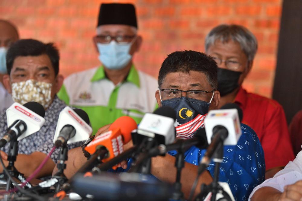 Melaka Umno chairman Datuk Seri Ab Rauf Yusoh (front right) speaks during a press conference in Melaka October 4, 2021. — Bernama pic
