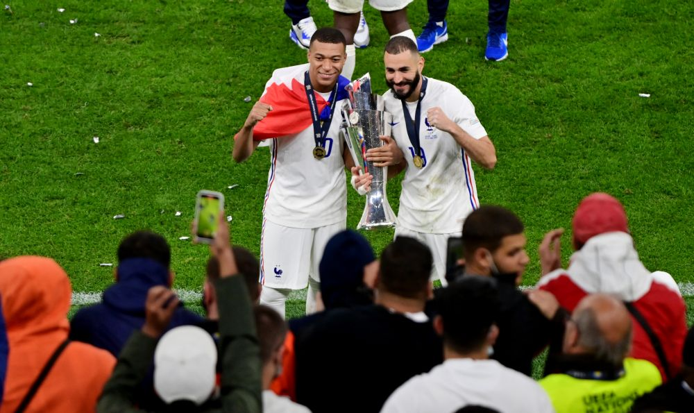 France's Kylian Mbappe and Karim Benzema celebrate with the trophy after winning the Nations League at San Siro, Milan October 10, 2021. — Reuters pic