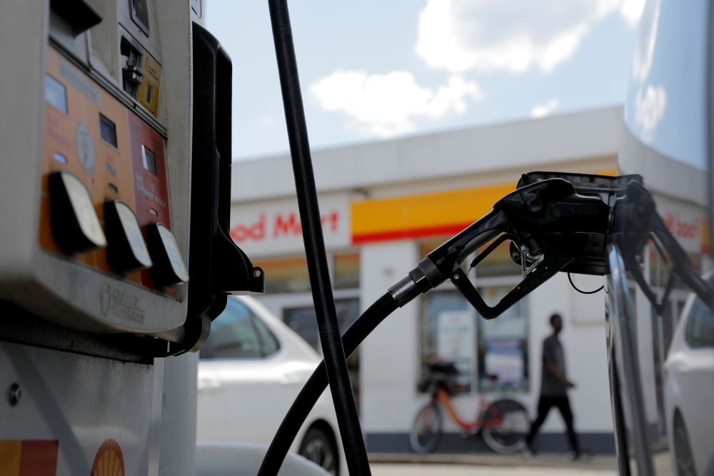 A gas pump is seen in a car at a Shell gas station in Washington DC, May 15, 2021. — Reuters pic