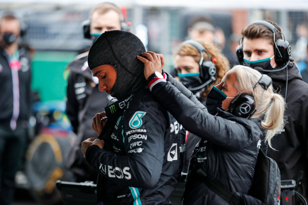 Mercedes driver Lewis Hamilton gets ready with his team prior to the start of the Formula One Grand Prix of Turkey at the Intercity Istanbul Park in Istanbul, October 10, 2021. — AFP pic