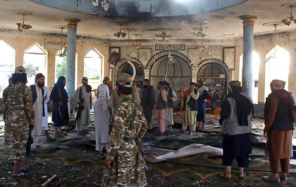 Taliban fighters investigate inside a Shiite mosque after a suicide bomb attack in Kunduz on October 8, 2021. — AFP pic