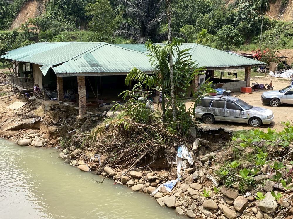 The riverside home where Andy Verus stays with 10 other people, including six children, have been repeatedly ravaged by floodwaters. — Picture by Julia Chan