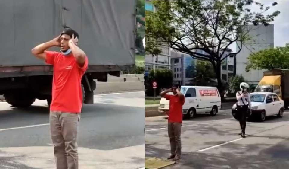 一名男子于周三下午在路中祷告,导致冼都华友花园一带路况出现混乱。-图截自视频-