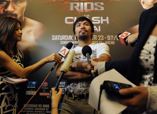 Philippine boxing icon Manny Pacquiao speaks to the media at Marina Bay Sands in Singapore on August 2, 2013. — AFP pic