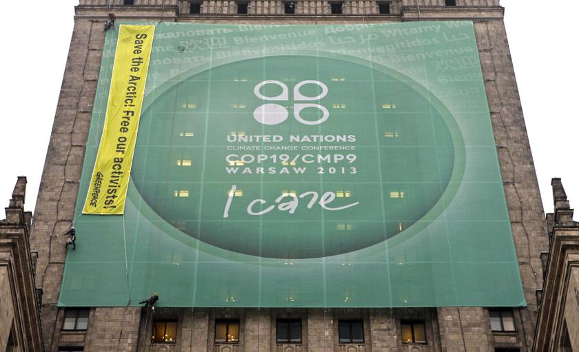 Greenpeace activists place a banner on the Palace of Culture and Science demanding protection of the Arctic region and the release of the so-called 'Arctic 30' group during COP19 in Warsaw November 21, 2013. —Reuters pic
