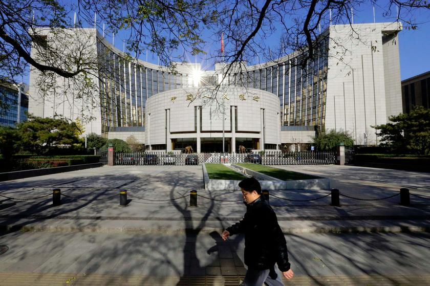 A man walks past the headquarters of the People's Bank of China (PBOC), the central bank in Beijing. — Reuters pic