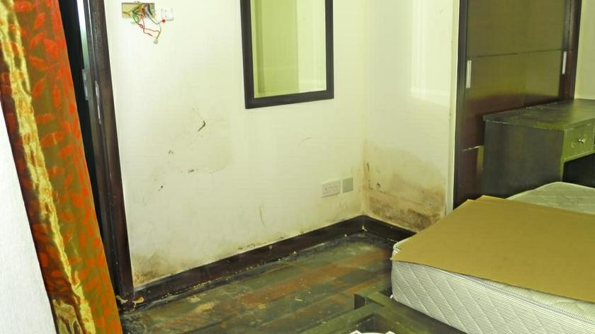Walls and floors of a villa unit that have grown mouldy because of long-term damp conditions, with Wrobel saying that some villas had water seeping from under the floorboards. — Picture by Nexus Property Owners' Association (NPOA)
