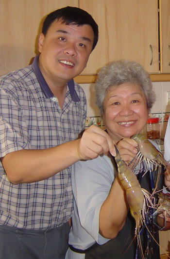 Terry Wong with his mother brandishing a bounty of freshwater prawns