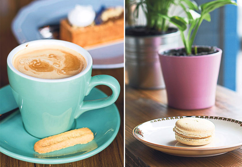Every cup of coffee comes with a buttery, homemade cookie stamped with the café's name (left). Try the not-too-sweet teh tarik macaron with a subtle hint of coconut (right)