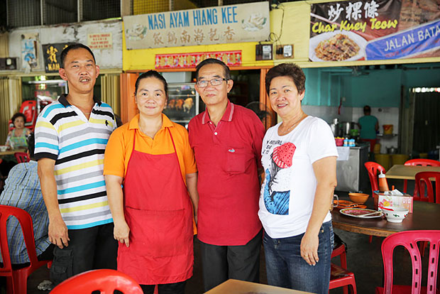 In front of their newly opened stall in Klang (from left to right) Khoo Meng Hian, Eng Lee Ling, Eng Kim Soong and his wife