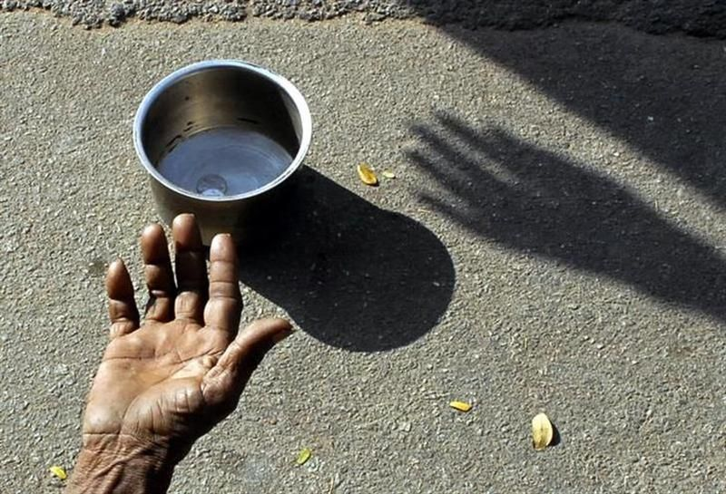 A beggar extends his hand for money at a street in Hyderabad. CAP today called on Putrajaya to set up a Royal Commission of Inquiry  to find out whether the recent UN report which stated that Malaysia's poverty rate is higher than official government figures is true. — Reuters pic
