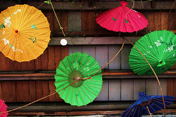 Rainbow-hued Chinese parasols dangle from the ceiling