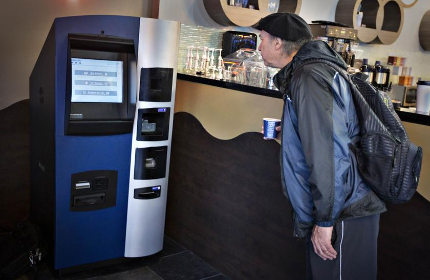 A man looks at the world's first ever permanent bitcoin ATM unveiled at a coffee shop in Vancouver, British Columbia October 29, 2013.— Reuters pic