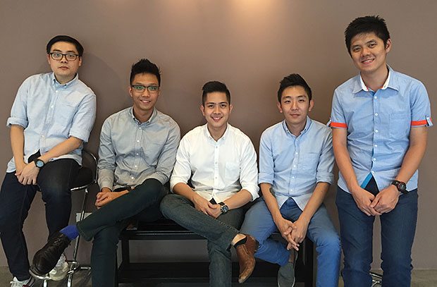The Carsome team with CEO Eric Cheng (second right) and Chief Operations Officer J. Teoh (centre).