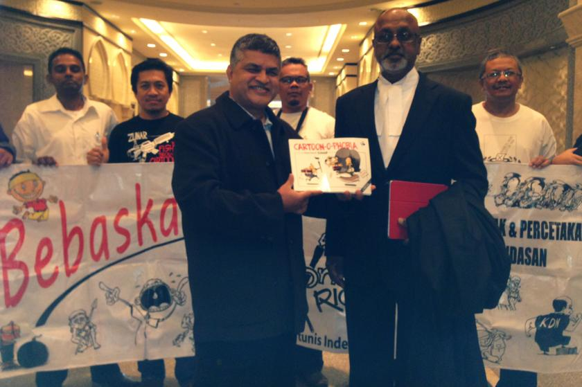 Cartoonist Zunar's (front, left) lawyer says her client's remand order was 'excessive' and 'unnecessary' as the police could have completed their investigations by today. ― File pic