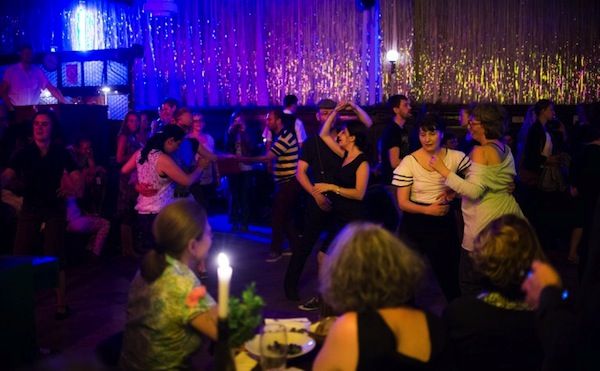 People dance during a Swing night in the hall of Claerchens Ballhaus on July 10, 2013 in Berlin. — AFP pic