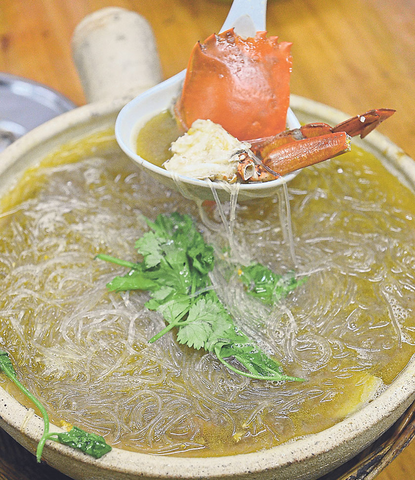 Slurp down the claypot crab served with glass noodles and a sweet peppery broth. – Pictures by James Tan