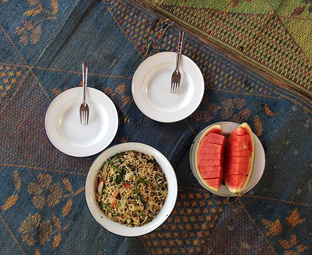 A fuss-free lunch of stir-fried noodles and watermelon, prepared by Karen women.