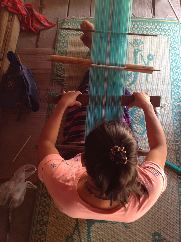 Fabric weaving is a specialty of Karen women, who turn them into shawls and clothes to sell to tourists.