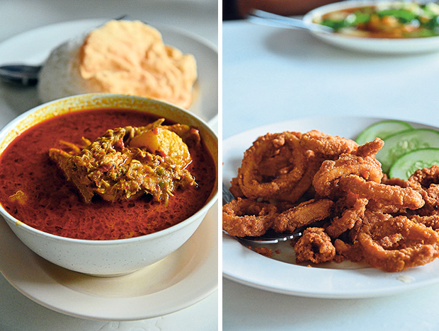 Try their weekends-only curry chicken with rice; the scary shade of red may seem intimidating but the spiciness is well tolerated even by non-spicy food lovers (left). Deep fried squid rings is a delightful snack that goes well with the Lingham's bottled chilli sauce (right). — Pictures by James Tan