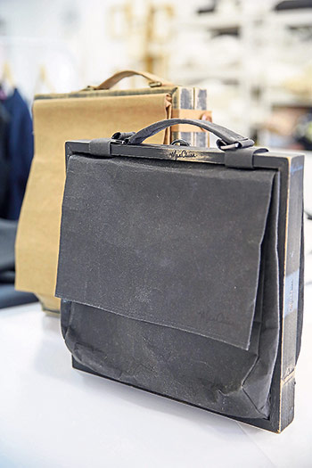 As a fashion designer with a sharp eye for details, Man Chien also has an accessory line with woodwork and treated paper