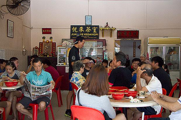 Regulars at Kedai Kopi Juat Lye happily tucking into their breakfast.
