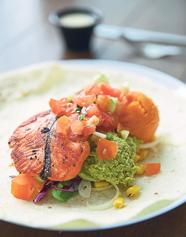 All their protein choices are freshly grilled upon order like this grilled salmon with mushy peas and sweet potato mash served as a wrap