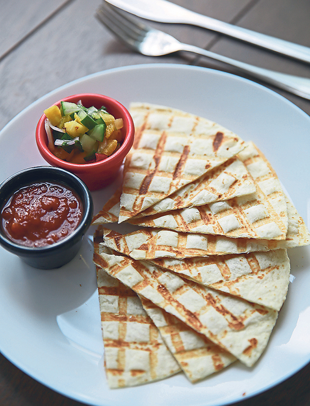 Toasted tortilla accompanied with your choice of sauces