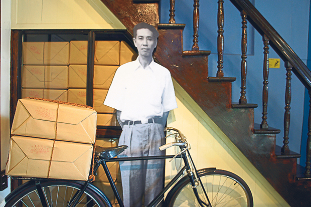 A cut out of the 'Cycling Entrepreneur' next to a vintage Japanese bicycle