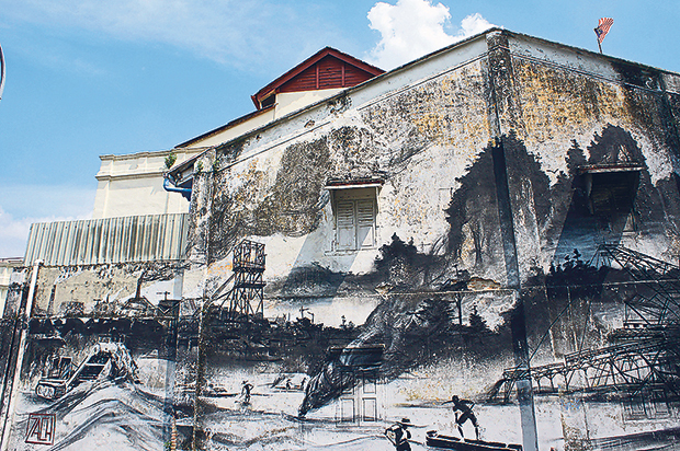 Ernest Zacharevic's Evolution on the exterior wall of the museum