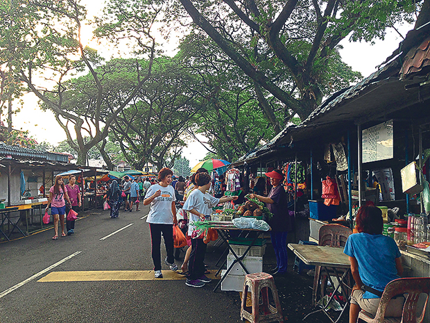 Shop, have breakfast and catch up on neighbourhood news at this market under the trees at Pasar Desa Setapak