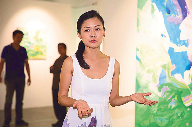 Sufei Liew of Art WeMe explaining the gallery's direction