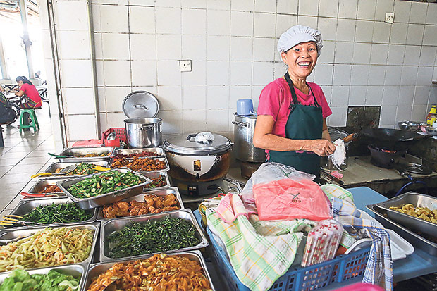 The friendly Hong Mook Yin from the Bangsar Vegetarian stall is happy to meet people via her business. — Pictures by Choo Choy May and Lee Khang Yi