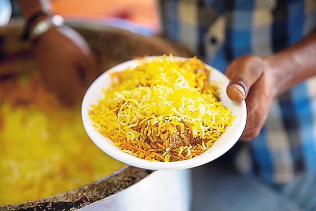 Simply beautiful saffron infused biryani straight from the pot at Hyderabad Biryani House.