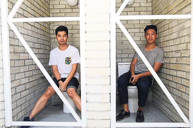 E. and Ong showcasing the functional and robust toilets — don't worry, it's still a work-in-progress and there will be actual doors! .