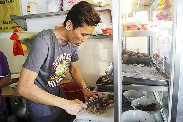 Albert Lai had honed his skills in Hong Kong to prepare beef noodles. — Pictures by Choo Choy May